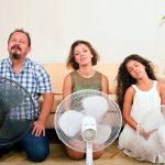 family-using-fans